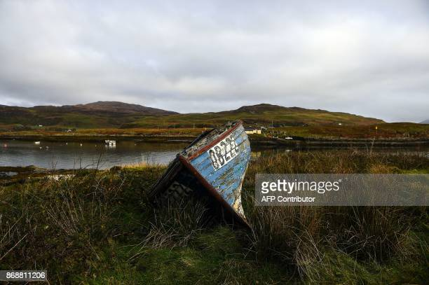 An abandoned boat sits on a grass verge on the Isle of Ulva off Scotland's west coast on October 20 2017 When tycoons in helicopters began landing on...