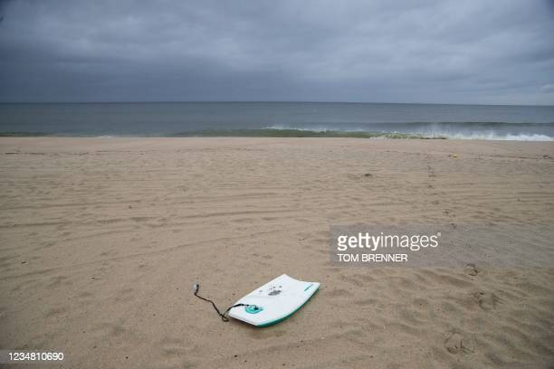 An abandoned boogie board lays along the shoreline as Tropical Storm Henri approaches, in Sea Bright, New Jersey, on August 22, 2021. - Tropical...