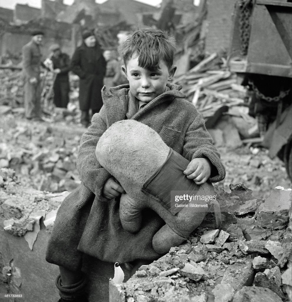 An Abandoned Boy Is Holding A Stuffed Toy Animal Amid