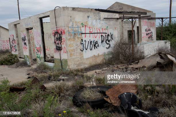An abandoned building off of route 90 is covered in anti-Trump graffiti, April 17 in rural West Texas.