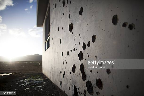 An abandoned building riddled with bullet holes and shrapnel marks at the Jaghatu District Center May 11 2009 in Jaghatu District Wardak Province...