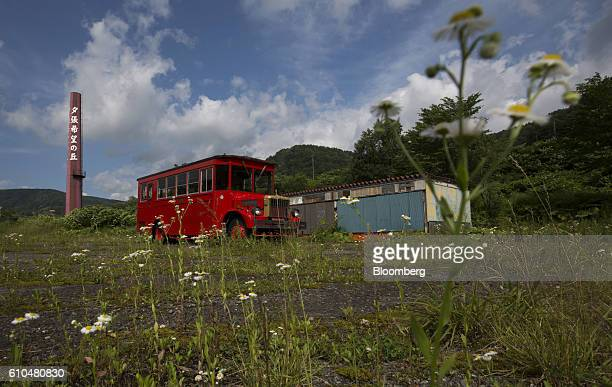 An abandoned bus stands at the Coal History Village in Yubari Hokkaido Japan on Thursday July 21 2016 Yubari a former coalmining town in northern...
