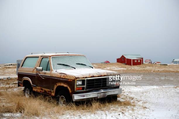 an abandoned car at hafnir, reykjanes peninsula, iceland - abandoned car stock photos and pictures
