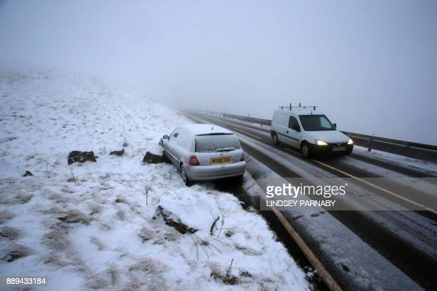 An abandoned car is parked at the roadside after skidding into a rock on one of the rural roads in Derbyshire northern England on December 10 2017...