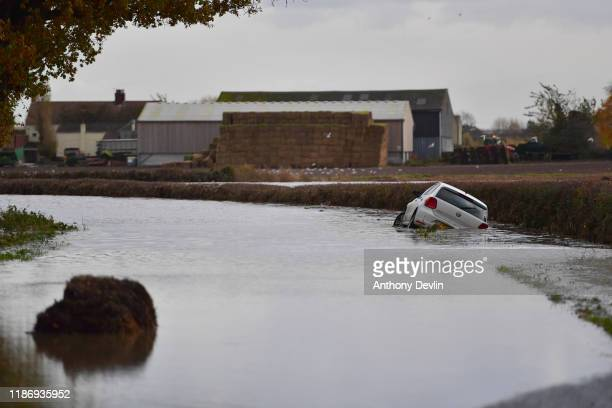 An abandoned car is seen in flood water on the road to Fishlake on November 11, 2019 in Doncaster, England. More heavy rain is expected in parts of...