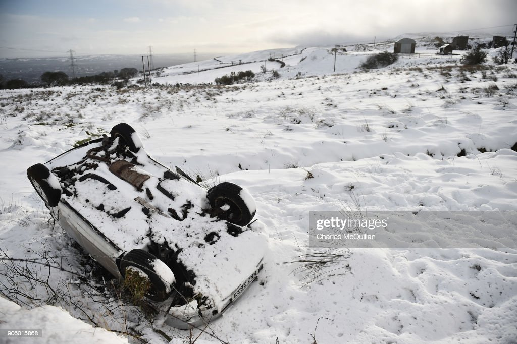 an abandoned car lays in a ditch due to adverse driving conditions on news photo getty images 2