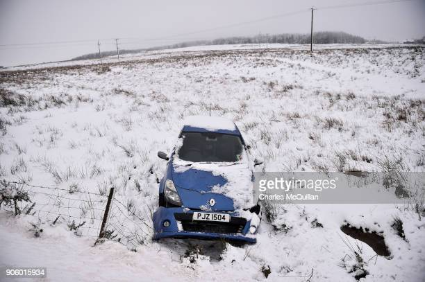An abandoned car lays in a ditch due to adverse driving conditions on January 17 2018 in Belfast Northern Ireland The Met Office has placed an amber...
