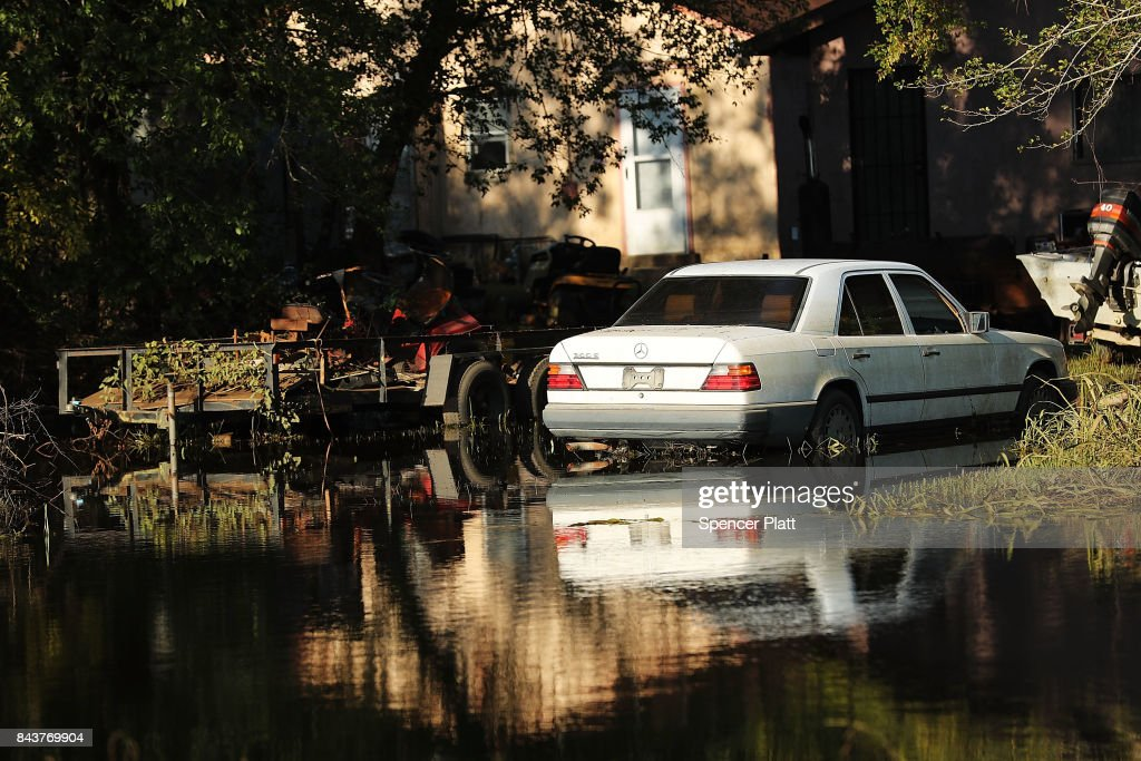 An abandoned car sits in high water along a street in Orange as Texas slowly moves toward recovery from the devastation of Hurricane Harvey on September 7, 2017 in Orange, Texas. Almost a week after Hurricane Harvey ravaged parts of the state, some neighborhoods still remained flooded and without electricity. While downtown Houston is returning to business, thousands continue to live in shelters, hotels and other accommodations as they contemplate their future.