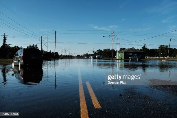 An abandoned car sits in high water along a street in Orange as Texas slowly moves toward recovery from the devastation of Hurricane Harvey on...