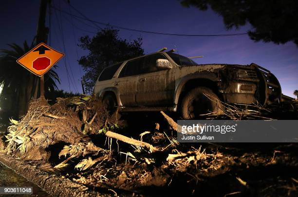 An abandoned car sits in mud following a mudslide on January 10 2018 in Montecito California 17 people have died and hundreds hundreds of homes have...