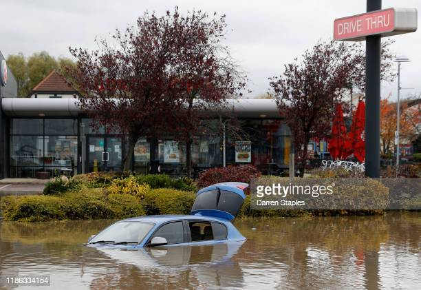 An abandoned car stands in flood waters on the Parkgate shopping park after the River Don burst its banks on November 08 2019 in Rotherham United...