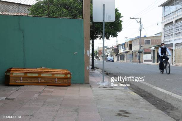 An abandoned coffin on lies on the sidewalk of Bolivia street between Guaranda and Capitán Zaera streets on April 6, 2020 in Guayaquil, Ecuador....