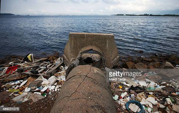 An abandoned drainage pipe sits on the edge of polluted Guanabara Bay on May 9 2014 in Rio de Janeiro Brazil The city is taking on a number of...