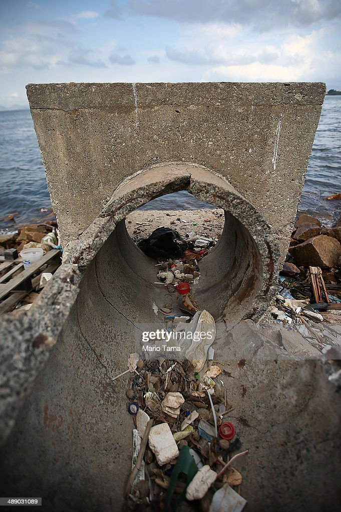 An abandoned drainage pipe sits on the edge of polluted Guanabara Bay, on May 9, 2014 in Rio de Janeiro, Brazil. The city is taking on a number of infrastructure projects and cleaning up Guanabara Bay, site of Olympic sailing events, in time for the Rio 2016 Olympic Games.