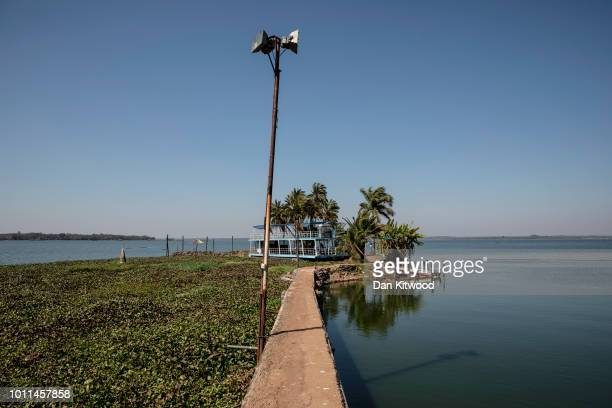 An abandoned floating restaurant surrounded by Water Hyacinth on Lake Chivero on August 5 2018 in Harare Zimbabwe Lake Chivero is 32KM South West of...