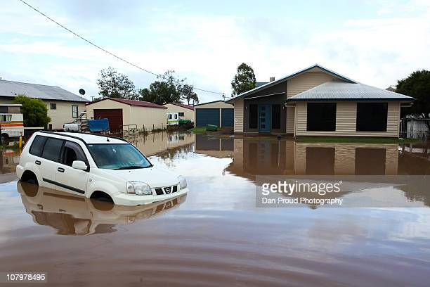 An abandoned fourwheeldrive sits in a flooded street on January 11 2011 in Oakey Australia 10 people so far have been confirmed dead in towns in the...