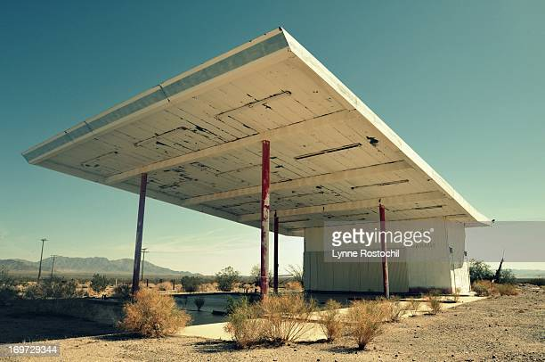 CONTENT] An abandoned gas station and garage slowly wastes away along old Route 66 in the California desert
