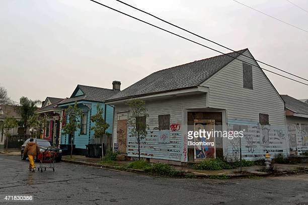 An abandoned, graffiti-covered home stands adjacent to occupied properties in the Bywater neighborhood of New Orleans, Louisiana, U.S., on Thursday,...