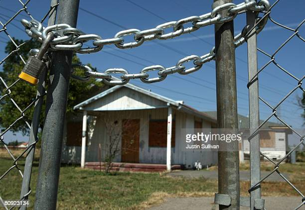 An abandoned home stands behind a padlocked gate April 29, 2008 in Stockton, California. As the nation continues to see widespread home loan...