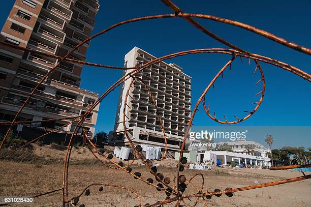 An abandoned hotel is seen in the Varosha quarter of the beach on January 5, 2017 in Famagusta, Cyprus. Prior to the Turkish invasion of Cyprus in...