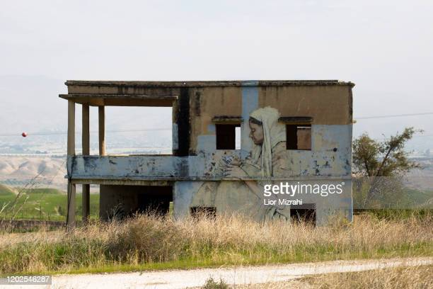 An abandoned house adorned with graffiti stands empty next to the Israel-Jordan border on January 28, 2020 in Jordan Valley, West Bank. U.S....