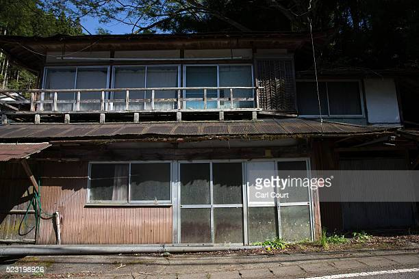 An abandoned house is pictured in a small village on April 22 2016 in Miyoshi Japan Many rural areas of Japan have become heavily depopulated as...