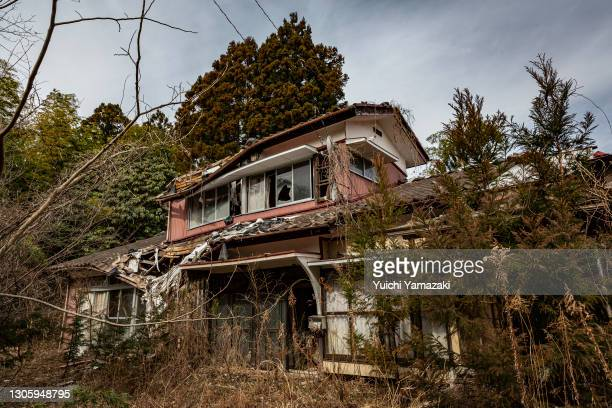 """An abandoned house is seen inside the """"difficult-to-return"""" zone on March 08, 2021 in Namie, Japan. In ceremonies that are expected to be scaled back..."""