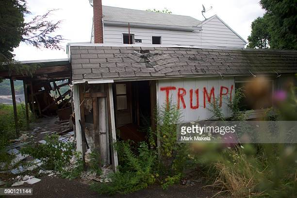 """An abandoned house is spray painted """"Trump!"""" on August 14, 2016 in Schuylkill County, Pennsylvania. This Northeastern Pennsylvania region has a rich..."""