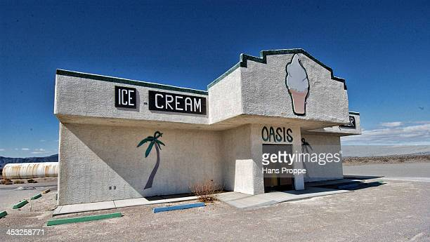 An abandoned ice cream parlor in the middle of nowhere in the Armagosa desert .