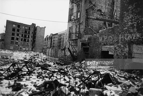 An abandoned lot on East 8th street lies in ruins after the city tore down two abandoned buildings that squatters had fixed up and made into homes....