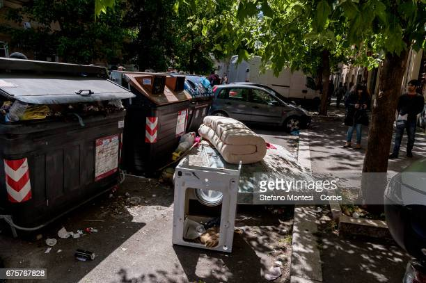 An abandoned mattress near the waste bins on the street in Torpignattara neighborhood on May 1 2017 in Rome Italy Rome has suffered in recent times...