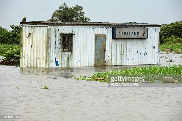 An abandoned office of a liquidated first generation bank submerged by flood is pictured at Wawa along Lagos - Ibadan expressway, Ogun State in...