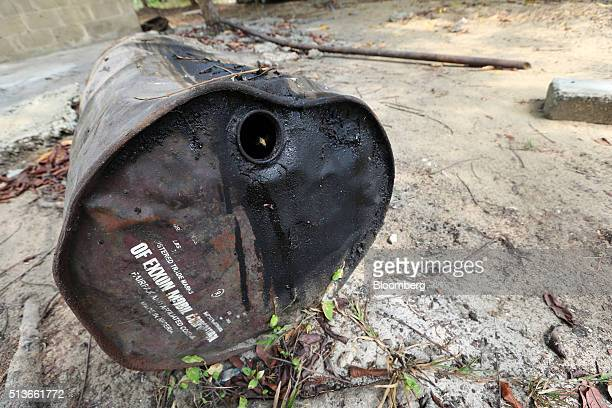 An abandoned oil drum branded with the Exxon Mobile Corp name and used for illegal refining activity sits on the ground in Bodo Nigeria Wednesday Jan...