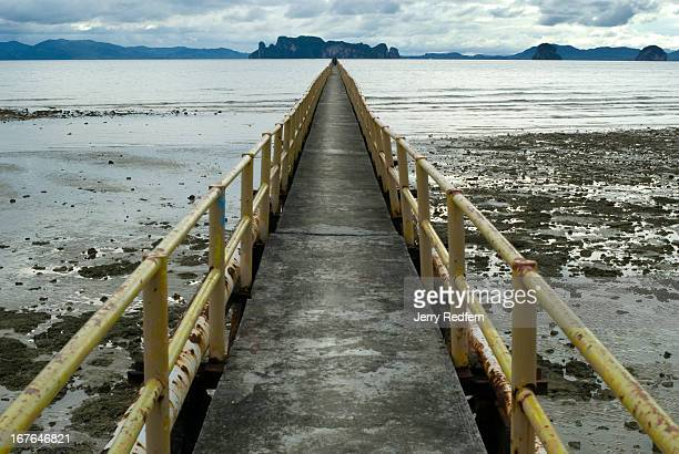 An abandoned pier leads into the Andaman Ocean from the coast north of Krabi town in southern Thailand The pier used to serve mines in the area