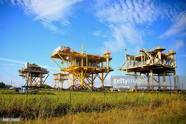 An abandoned production platform sits on land waiting to be sold at the Port of Iberia, in New Iberia, Louisiana, U.S., on Friday, Aug. 19, 2016. The...