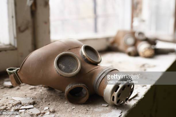 An abandoned protection masks in the deserted building near bypass channel for cooling at the Chernobyl nuclear power plant in the Exclusion Zone...