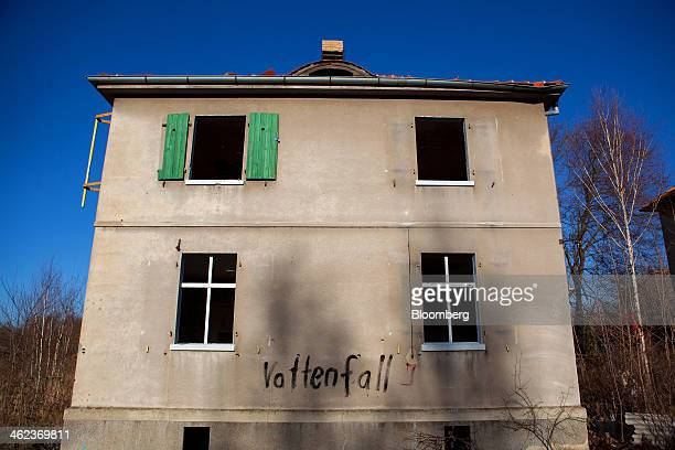 An abandoned residential property stands in a village near the WelzowSued openpit brown coal mine operated by Vattenfall AB in Proschim Germany on...
