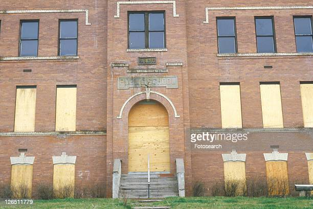 an abandoned schoolhouse - boarded up stock photos and pictures