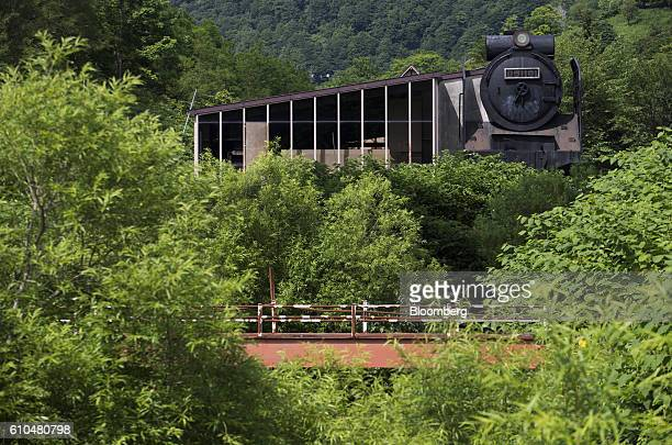 An abandoned steam locomotive shaped building stands at the Coal History Village in Yubari Hokkaido Japan on Thursday July 21 2016 Yubari a former...