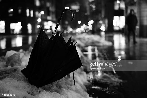 An abandoned umbrella is viewed in the snow and rain on February 13 2014 in New York City In what is turning out to be one of the snowiest winter's...