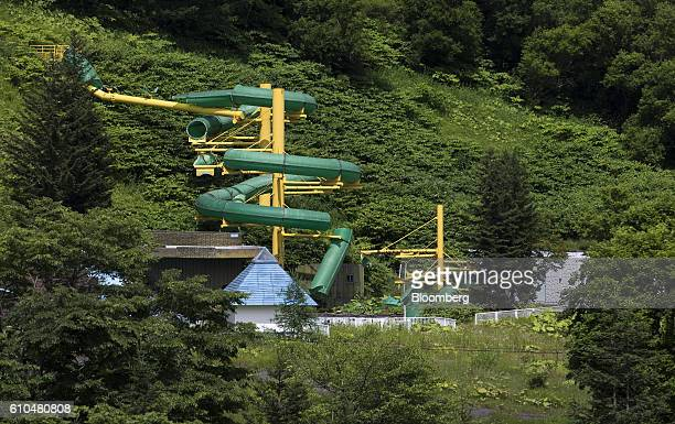 An abandoned water slider stands at the Coal History Village in Yubari Hokkaido Japan on Thursday July 21 2016 Yubari a former coalmining town in...