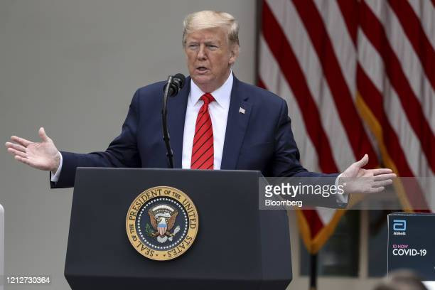 An Abbott Laboratories ID Now Covid-19 test kit stands next to U.S. President Donald Trump speaking during a press briefing in the Rose Garden of the...