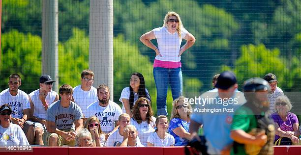 An Abingdon fan shouts support to her team in the bottom of the 7th inning as Woodgrove defeats Abingdon 3 1 in Virginia State AA girls softball...
