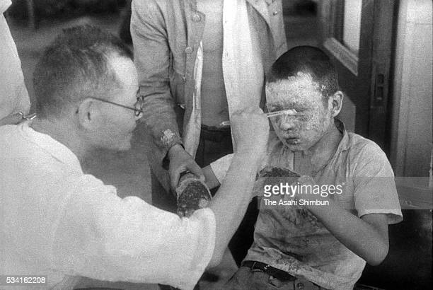 An a-bomb exposed boy receives medical treatment at the Hiroshima Red Cross hospital on Augusut 10, 1945 in Hiroshima, Japan. The world's first...