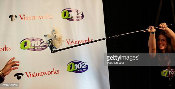 An abominable snowman with a camera is used to surprise red carpet attendees at Q102��€���s Jingle Ball 2012 at the Wells Fargo Center in...