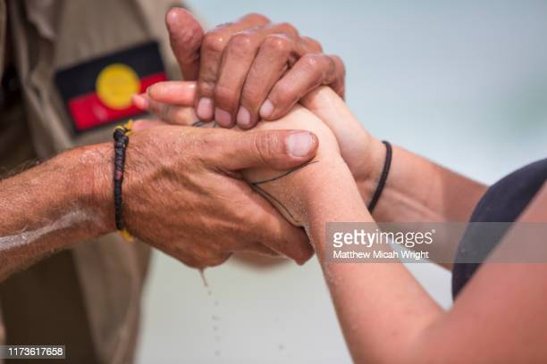 an aboriginal cultural ceremony involving hand painting. - ceremony stock pictures, royalty-free photos & images