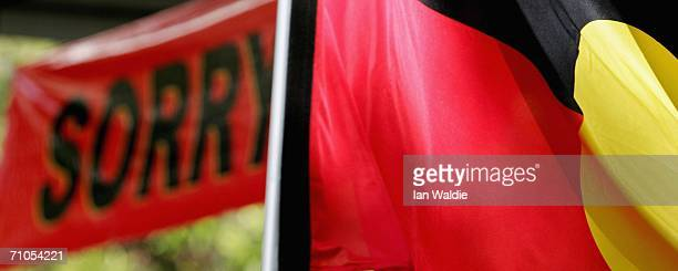 An Aboriginal flag files near a 'Sorry' banner during an event to mark Sorry Day May 26 2006 in Sydney Australia The first National Sorry Day was...