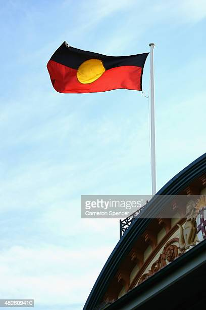 An aboriginal flag is seen above the members stand during the round 18 AFL match between the Sydney Swans and the Adelaide Crows at Sydney Cricket...