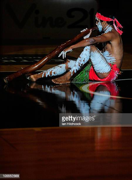 An Aboriginal performer plays the didgeridoo before the start of the round one NBL match between the Townsville Crocodiles and the Cairns Taipans at...