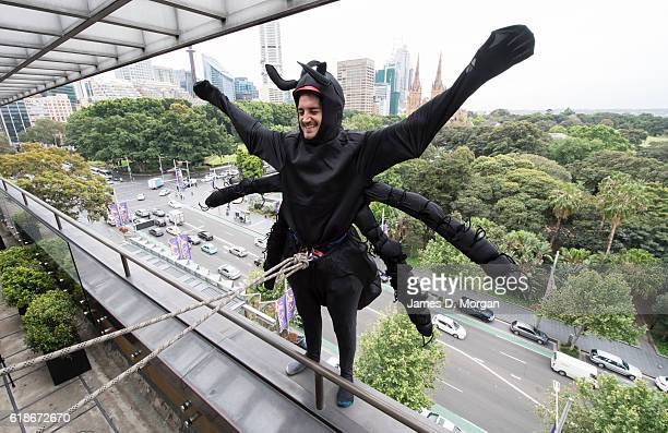 An abseiling spider about to descend the outside wall at the Australian Museum on October 28 2016 in Sydney Australia The event was to celebrate the...